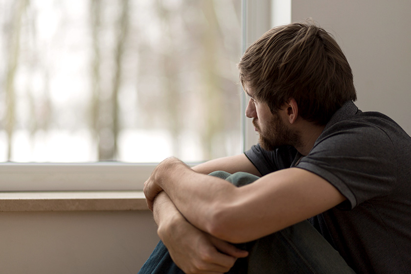 man struggling with seasonal depression